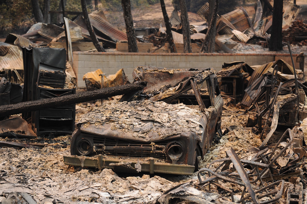 . A burnt car at a burnt house in the 43300 block of Lake Hughes Road from the Powerhouse Fire, Sunday, June 2, 2013. (Michael Owen Baker/Staff Photographer)
