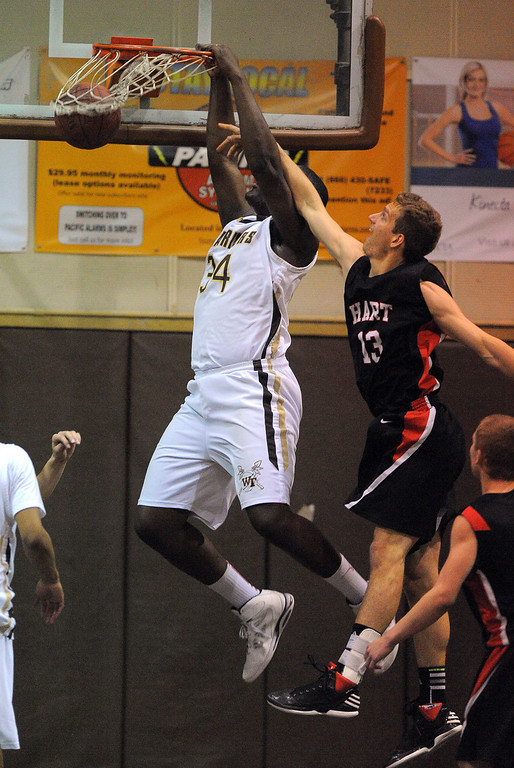 . TORRANCE - 02/15/2013 - (Staff Photo: Scott Varley/LANG) In a CIF Southern Section Division III-AAA second-round boys basketball matchup, West beat Hart 64-55. West\'s Terrell Carter dunks against Nolyn Preston.