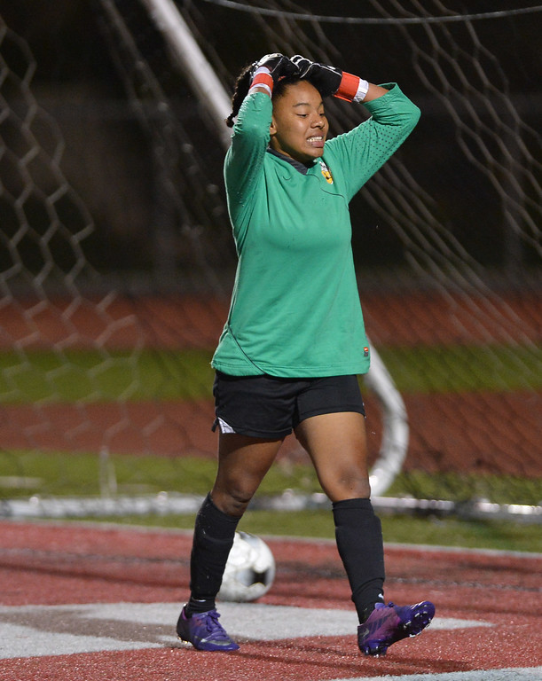 . TS20-GREATOAK-REDONDO--- Redondo Beach, CALIFORNIA--2/19/13--- Staff Photo: Robert Casillas / LANG--- Great Oak (Temecula) at Redondo girls CIF Division II soccer playoff. Great  Oak won on penalty kicks 20-19 after 0-0 overtime tie. Redondo GK Marissa Marshall is upset after getting hand on PK shot that went in.