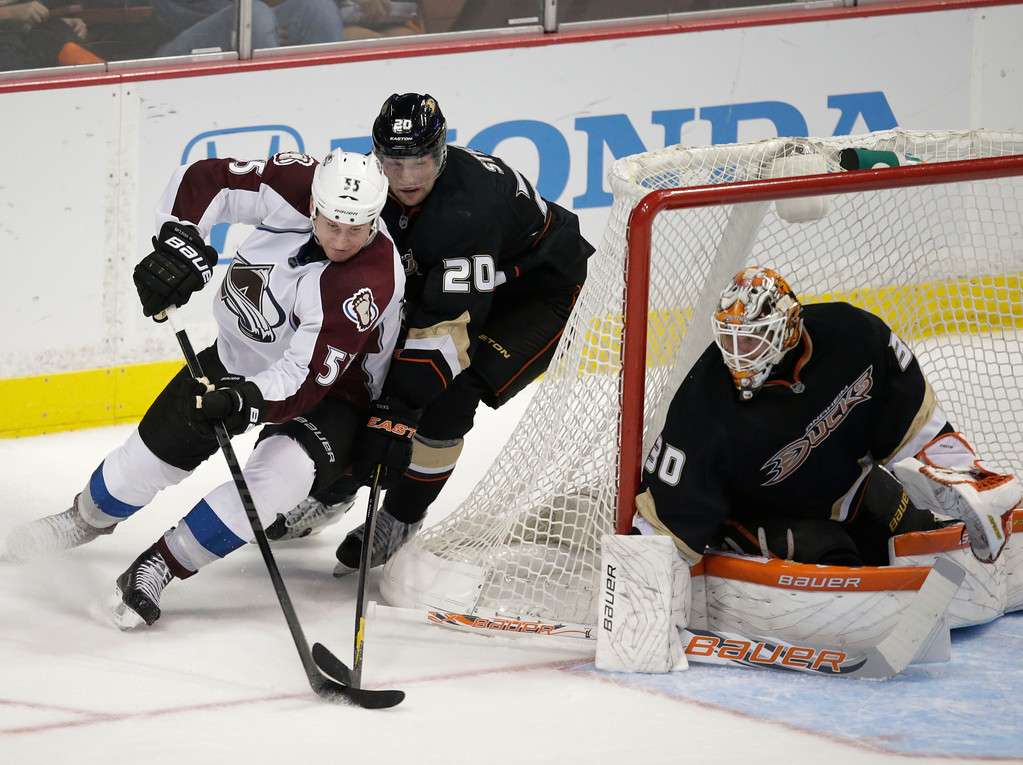 . Colorado Avalanche\'s Cody McLeod, left, is defended by Anaheim Ducks\' David Steckel as Anaheim Ducks goalie Viktor Fasth, of Sweden, watches during the third period of an NHL hockey game in Anaheim, Calif., Wednesday, April 10, 2013. The Avalanche won 4-1. (AP Photo/Jae C. Hong)