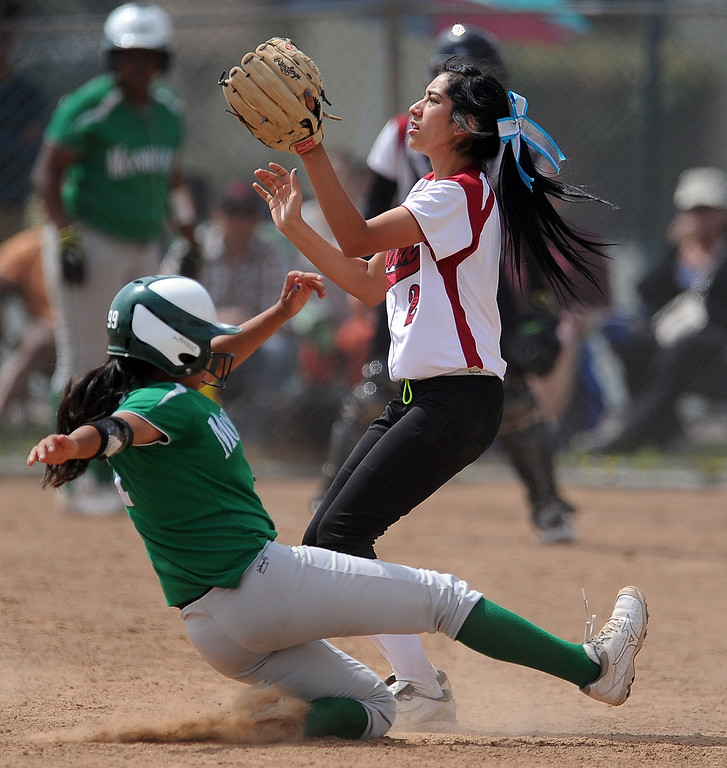 Description of . Monrovia's Galvan Tanya safe at third base on a triple as Covina third baseman Amber Medrano waits for the ball in the third inning of the Northview Tournament championship softball game at Northview High School on Thursday, April 4, 2013 in Covina, Calif.  Monrovia won 6-0. 