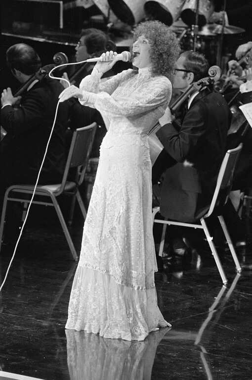 ". Barbra Streisand sings to a packed house May 7, 1978 in Los Angeles, Calif., during the taping of ""The Stars Salute to Israel at 30.\""  Streisand was one on many Hollywood stars who entertained at the show which was to celebrate Israel\'s 30th anniversary.  (AP Photo/Wally Fong)"