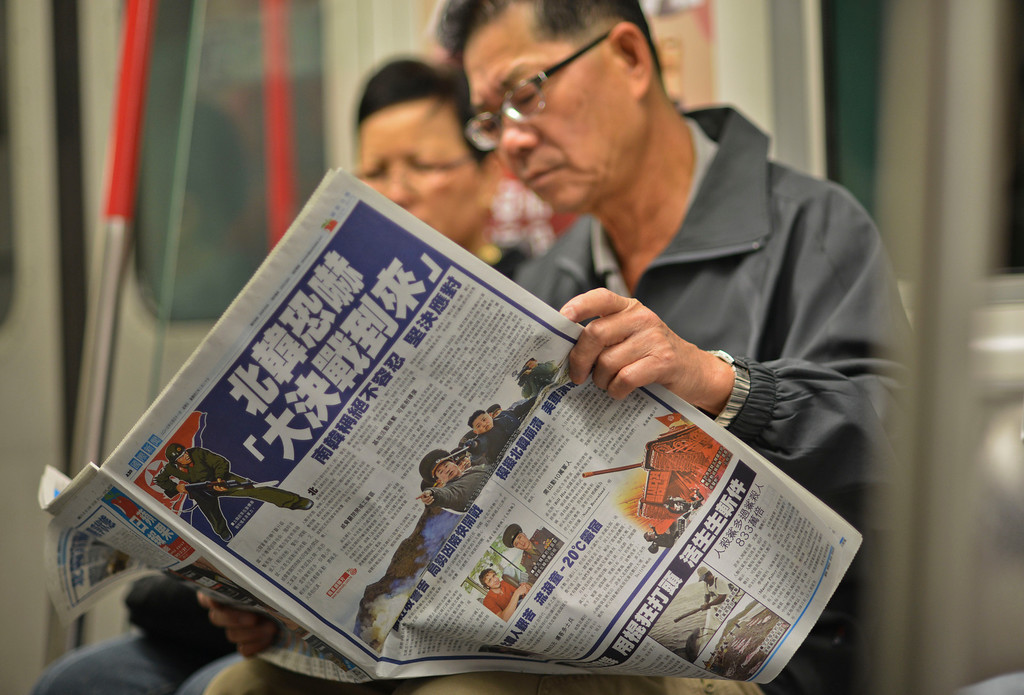 ". A man sitting on the underground in Hong Kong reads a Chinese language newspaper leading with reports on the recent North Korean military developments on March 31, 2013.  North Korea on March 30 declared it was in a ""state of war\"" with South Korea and warned Seoul and Washington that any provocation would swiftly escalate into an all-out nuclear conflict. China, North Korea\'s sole major ally and biggest trading partner, appealed for \""joint efforts\"" to reduce tensions on the Korean peninsula on March 29.     AFP PHOTO / Antony DICKSON        (Photo credit should read ANTONY DICKSON/AFP/Getty Images)"