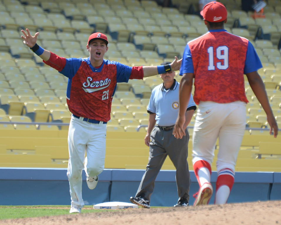 . Serra\'s Trent Hammond (21) and closing pitcher Solemon Bates (19) let the celebration begin after they beat Mira Costa in the CIF-SS Division III championship baseball game Friday at Dodger Stadium. Serra won the title, 8-1. 20130531 Photo by Steve McCrank / Staff Photographer