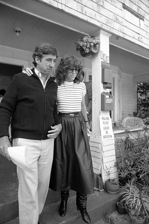 . Democrat Tom Hayden, a candidate for a California state assembly seat, and his wife, actress Jane Fonda, leave polling place in Santa Monica, California, June 8, 1982, after casting their votes. Returns indicated a light voter turnout in the state primary elections. (AP Photo/Reed Saxon)