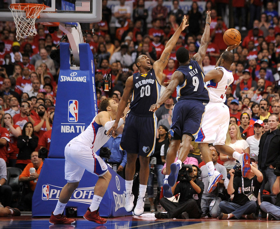 . Chris Paul puts up the game winning shot in the final seconds against the Memphis Grizzlies during game 2 of the 2013 NBA Western Conference Playoffs April 22, 2013 in Los Angeles, CA.  The Clippers won the game 93-91.(Andy Holzman/Staff Photographer)