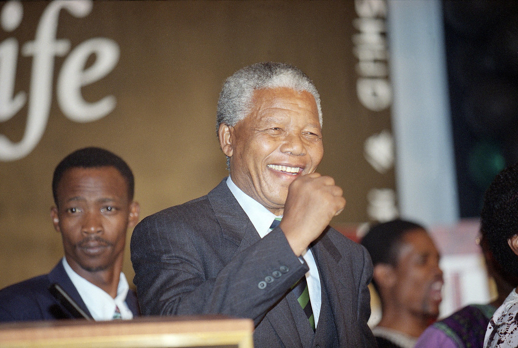 . Nelson Mandela smiles during his victory speech in Johannesburg on Monday May 2, 1994. Mandela will become  South Africa\'s first black president following his majority win in the historic all-race elections. (AP Photo/John Parkin)