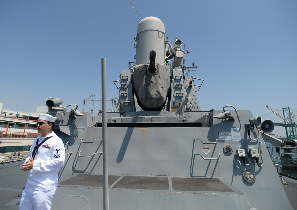. People take a tour of the USS Spruance, an Arleigh Burke-class guided missile destroyer, which is docked in the Port of Los Angeles for Navy Days.  FC2 Joel Raygoza (SW) explains the radar-guided gun system that is used in defense of the ship. Saturday, August 09, 2014, San Pedro, CA.   Photo by Steve McCrank/Daily Breeze