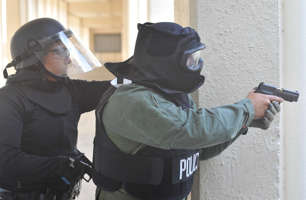 . Whittier Police Officers participate in Active Shooter Scenario training on the Whittier High School campus on Tuesday July 23, 2013. The department is putting all 120 of its officers throug three different scenarios during the two-days of training at the high school. (SGVN/Staff Photo by Keith Durflinger)