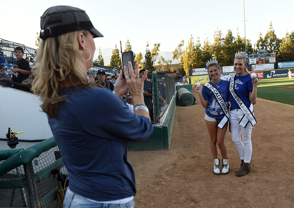 Description of . Ms. Jr. Teen California Alina Carranza and Ms. California 2014 Sande Charles pose for a photo before throwing out the first pitches at the Quakes game at LoanMart Field in Rancho Cucamonga, CA, Friday, August 15, 2014. (Photo by Jennifer Cappuccio Maher/Inland Valley Daily Bulletin)