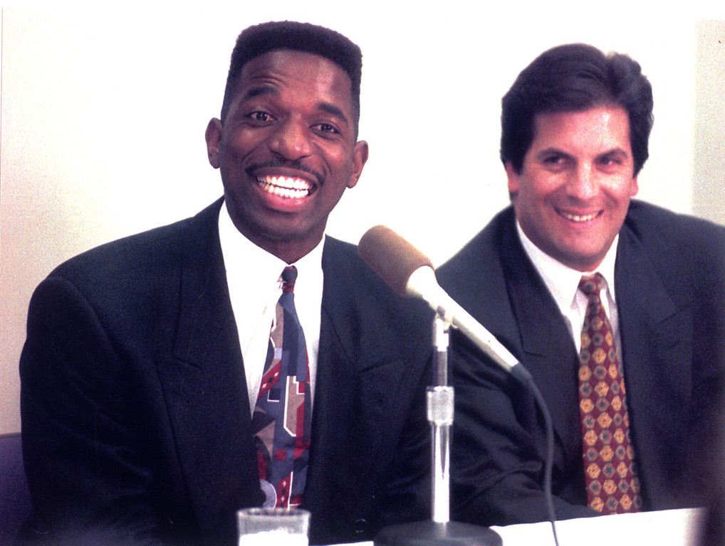 . 1993: A.C. Green, left, with his agent Mark Fleischer, signed 5-year, $15 million contract with Phoenix.  Associated Press