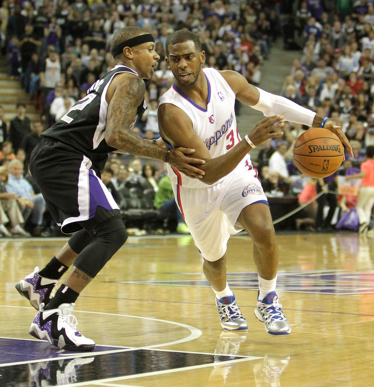 . Los Angeles Clippers  guard Chris Paul, right, drives against Sacramento Kings guard Isaiah Thomas during the fourth quarter  of an NBA basketball game in Sacramento, Calif., Wednesday,  April 17, 2013.  The Clippers own 112-108.(AP Photo/Rich Pedroncelli)