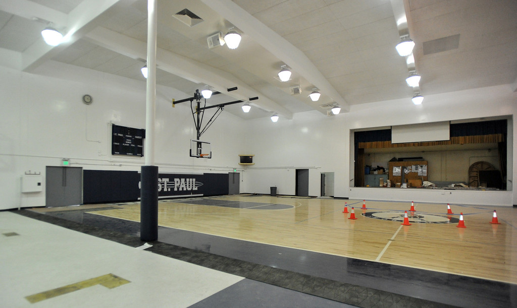 . The gym floor and other improvements are nearly completed at St. Paul High School in Santa Fe Springs on Friday August 9, 2013. St. Paul officials, students, and alumnae will dedicate the school\'s new football field and volleyball and basketball floors on Saturday.