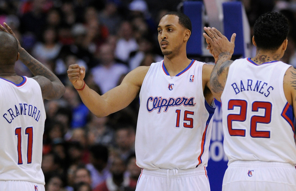. Clippers#15 Ryan Hollins and Jamal Crawford and Matt Barnes celebrate in the 4th quarter. The Clippers defeated the Minnesota Timberwolves 111-95 in a game played at Staples Center in Los Angeles, CA 4/10/2013(John McCoy/Staff Photographer