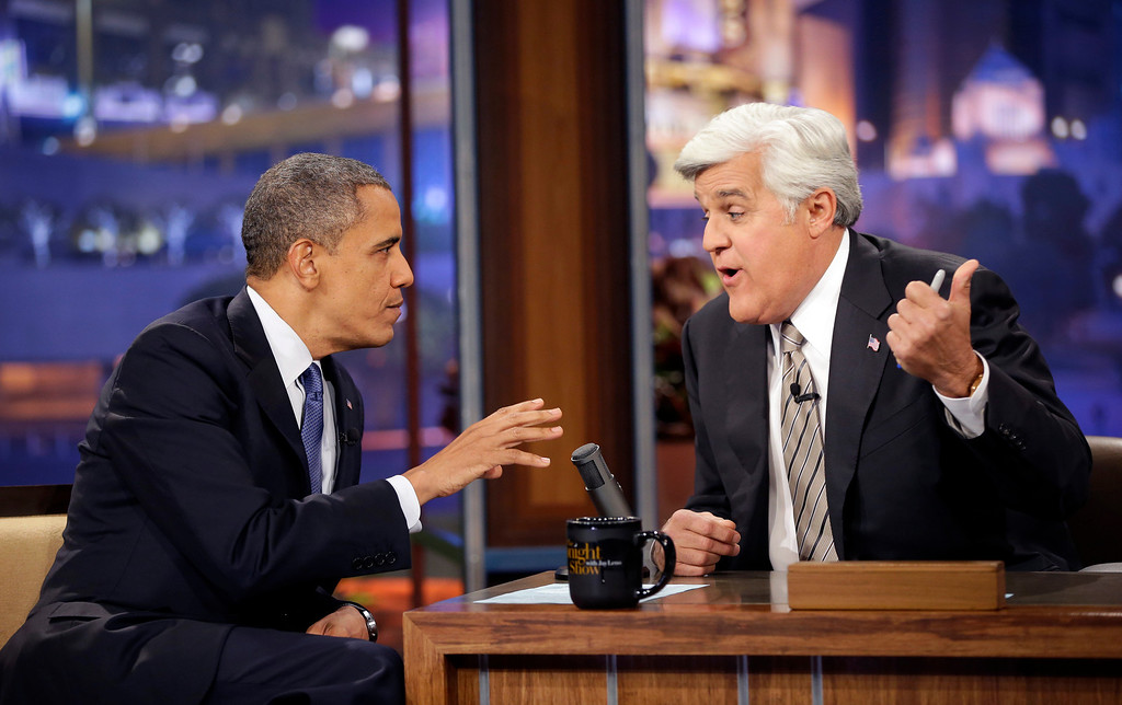 . President Barack Obama, left, talks with Jay Leno, right, during a commercial break during the taping of his appearance on NBC�s The Tonight Show with Jay Leno, Wednesday, Oct. 24, 2012, in Burbank, Calif. (AP Photo/Pablo Martinez Monsivais)