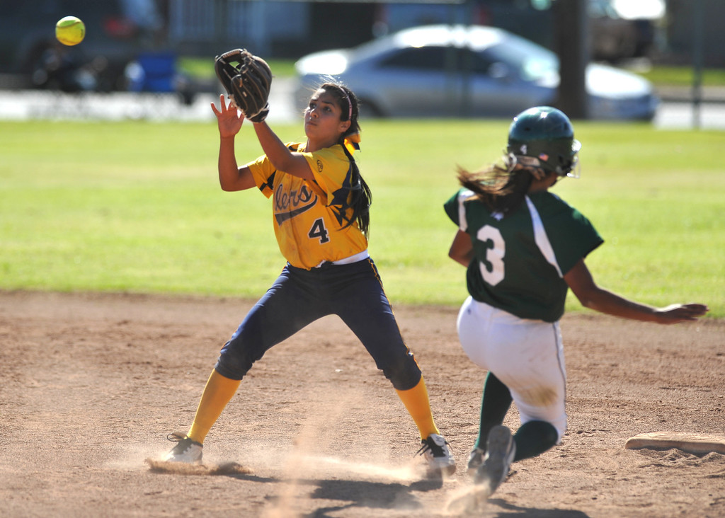 . Montebello shortstop Brianna Alvarez (#4) receives the ball as Schurr\'s Christa Martinez (#3) slides into second base safely when the ball came free in their Almont League girls softball game at Montebello High School on Thursday April 18, 2013. Montebello beat Schurr 10-8. (SGVN/Staff Photo by Keith Durflinger)
