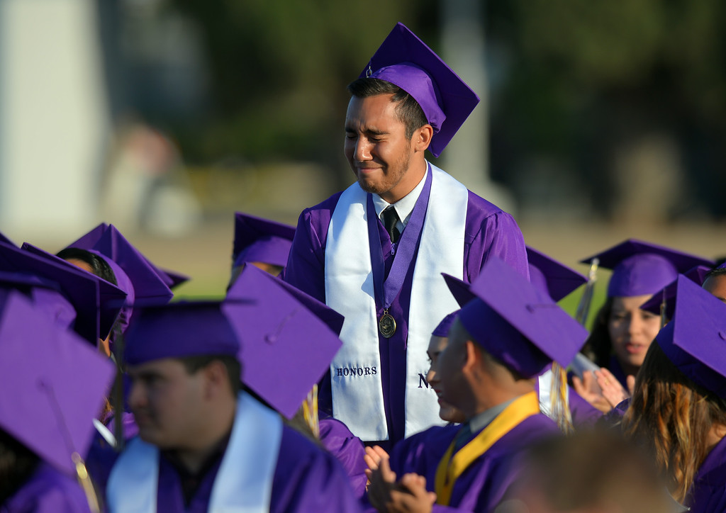 . Christian Rios breaks down after his mother, school board President Margarita Rios, singled him out during her speech. Norwalk High School\'s graduating class of 2014 goes through their commencement ceremony at Excelsior High School\' football stadium in Norwalk, CA on Tuesday, June 17, 2014. (Photo by Scott Varley, Daily Breeze)