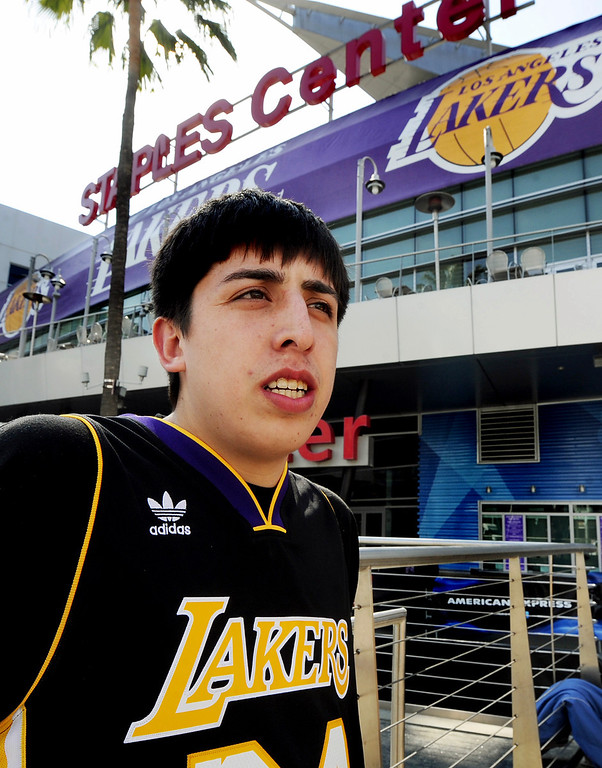 . Austin Garza 21, of Lancaster, came to the Staples Center to pay respects to the Buss\' family and the Lakers in Los Angeles on Monday, February 18, 2013. Dr. Jerry Buss died today after a long battle with cancer. (SGVN/Photo by Walt Mancini/SXCity)