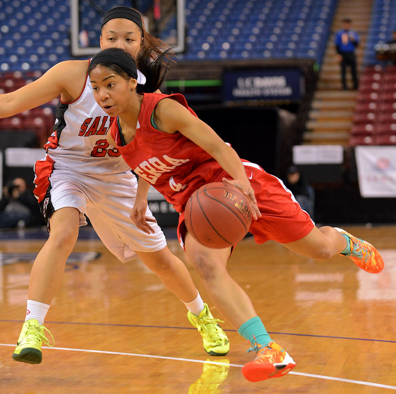 . Serra High School\'s Deandrea Toler  makes a move around Taylor Crowder of Salesian High during the Division IV 2013 CIF State Basketball Championships at Sleep Train Arena, in Sacramento, Ca March 23, 2013.  Serra won the game 62-60.(Andy Holzman/Los Angeles Daily News)
