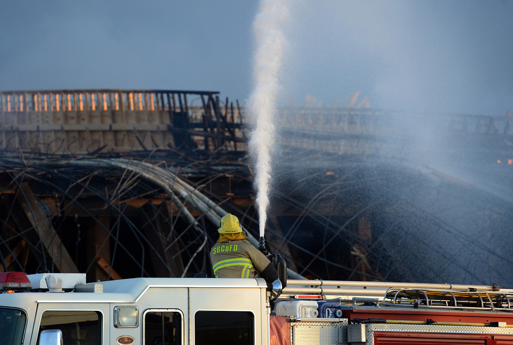. Crews work to demolish the Ranchero Road bridge on the 15 freeway, after catching fire Monday afternoon, in Hesperia, CA, Tuesday, May 6, 2014. The fire, which started Monday afternoon, forced the closure of the freeway in both directions. (Photo by Jennifer Cappuccio Maher/Inland Valley Daily Bulletin)
