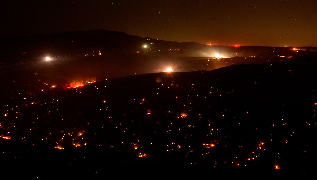 . The Silver Fire lights up the night near Banning, California August 7, 2013.  Hundreds of residents of three small communities in the high desert east of Los Angeles were evacuated on Wednesday as an out-of-control wildfire headed toward them.    Photo by Gene Blevins/LA Daily News