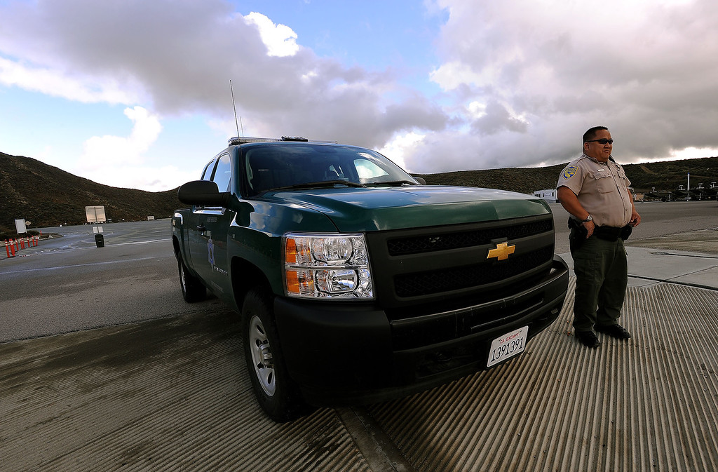 Description of . California Department of Fish and Wildlife Warden Kyle Chang patrols Diamond Valley Lake marina in Hemet March 8, 2013.  GABRIEL LUIS ACOSTA/STAFF PHOTOGRAPHER.