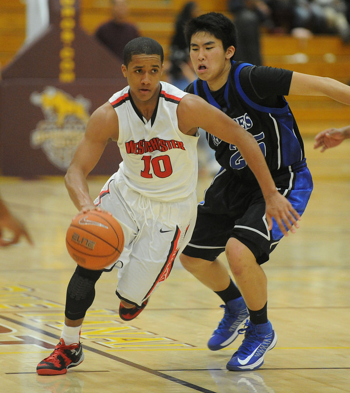 . 02-23-2012--(LANG Staff Photo by Sean Hiller)- Palisades vs. Westchester in Saturday\'s L.A. City Section Division I semifinal boys basketball game at Cal State Dominguez Hills in Carson. Tyler Batiste drives down court ahead of Louis Kurihara.