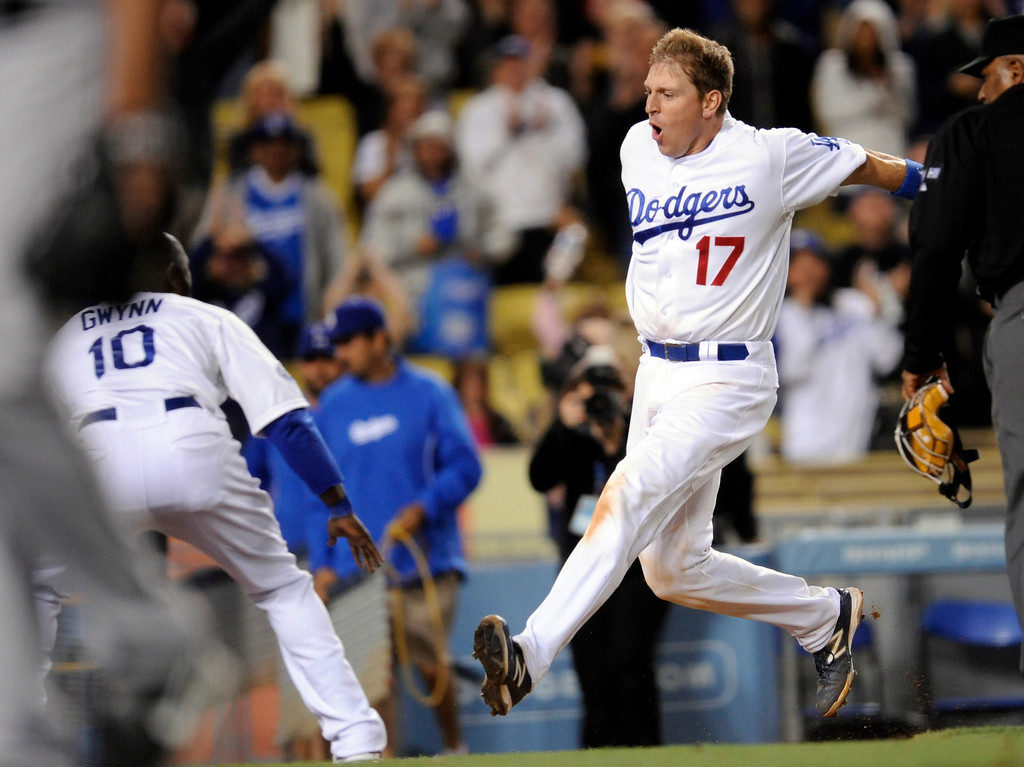 . The Dodgers\' A.J. Ellis #17 rounds the bases on his walk off homer in the bottom of the 9th inning to beat the Astros 6-3 during their game at Dodger Stadium Saturday, May 26, 2012. (Hans Gutknecht/Staff Photographer)