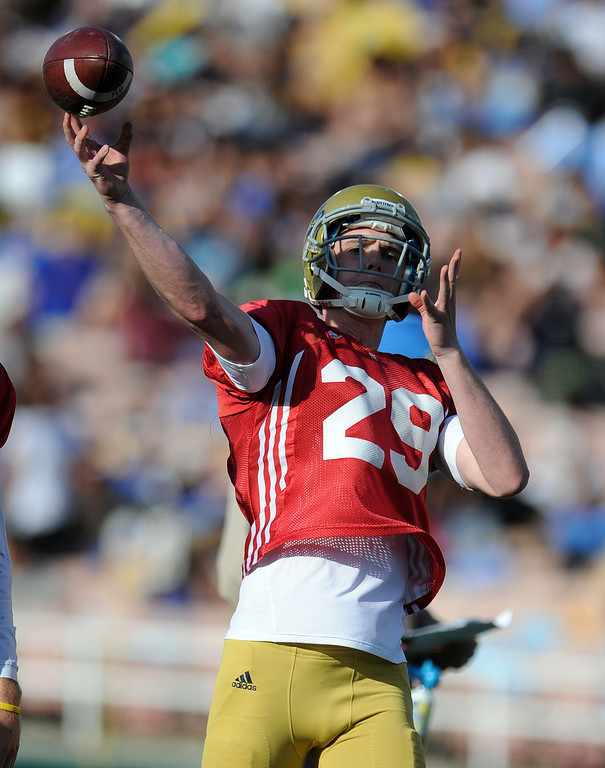 Description of . \UCLA quarterback Jake Hall (29) during the football spring showcase college football game in the Rose Bowl on Saturday, April 27, 2013 in Pasadena, Calif.    (Keith Birmingham Pasadena Star-News)