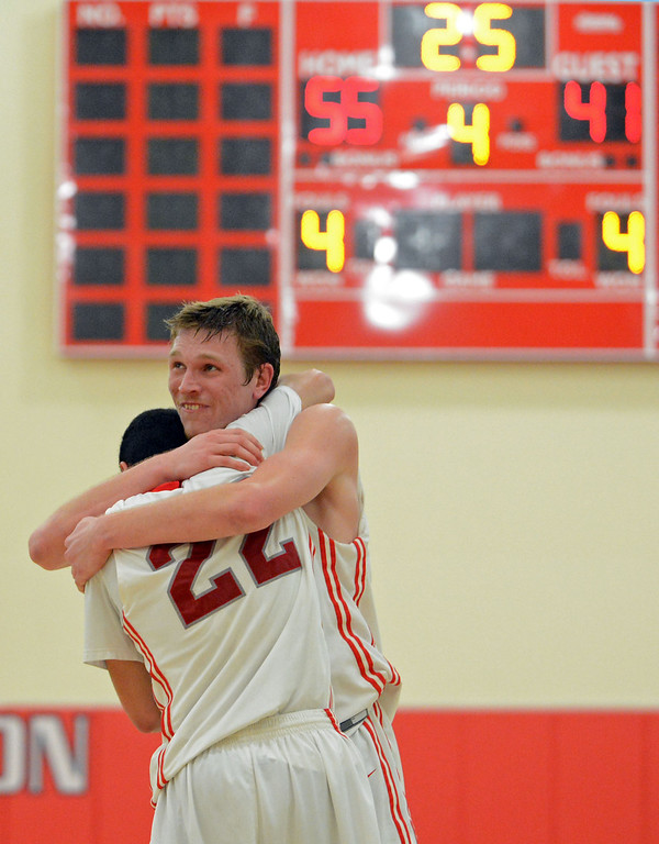 . Redondo Union\'s Sebastian Lindner (13) and Chris Henderson (22) begin to celebrate as time runs out on the scoreboard against Arroyo Grande in a CIF Southern Section Division II-A semifinal boys basketball game Tuesday night in Redondo Beach. 20130226 Photo by Steve McCrank / Staff Photographer