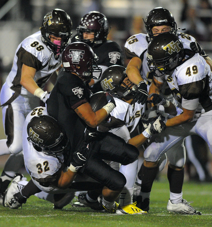 . West High takes on Torrance in a non league football game at Zamperini Stadium in Torrance, CA on Thursday, September 12, 2013. West defender bring Torrance\'s Sean Luna down for a stop and a loss of yards. (Photo by Scott Varley, Daily Breeze)