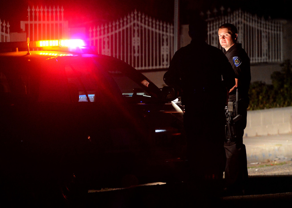 . San Bernardino police investigate the scene of a quadruple shooting in the 2900 block of Mountain Ave in San Bernardino, CA, Friday, March 28, 2014. (Photo by Jennifer Cappuccio Maher/Inland Valley Daily Bulletin)