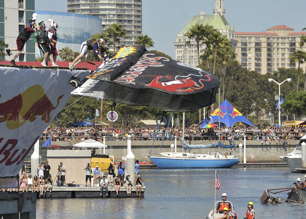". LONG BEACH, CALIF. USA -- Ronnie Shelton pilots his team\'s Flugtag entry ""Sgt. Pepper\'s Flying Piano\"" in Rainbow Harbor in Long Beach, Calif. on August 21, 2010. Thirty five teams competed in the Red Bull event where teams build homemade, human-powered flying machines and pilot them off a 30-foot high deck in hopes of achieving flight.  Flugtag means \""flying day\"" in German. They are on distance, creativity and showmanship..Photo by Jeff Gritchen / Long Beach Press-Telegram.."