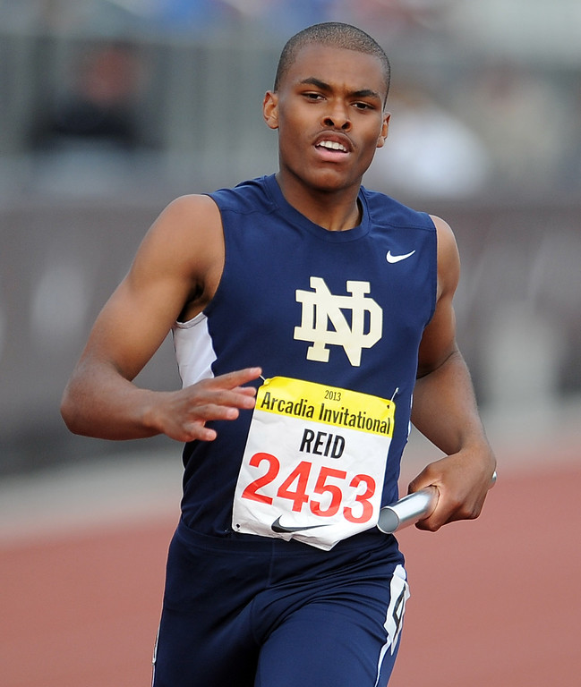 Description of . Notre Dame's Trevor Reid competes in the 4x200 rated race during the Arcadia Invitational at Arcadia High School on Friday, April 5, 2013 in Arcadia, Calif.  (Keith Birmingham Pasadena Star-News)