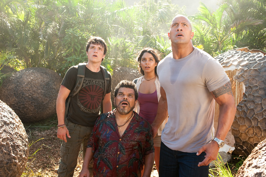 ". In this image released by Warner Bros. Pictures, from left, Josh Hutcherson, Luis Guzman, Vanessa Hudgens and Dwayne Johnson are shown in a scene from ""Journey 2: The Mysterious Island.\"" (AP Photo/Warner Bros. Pictures, Ron Phillips)"