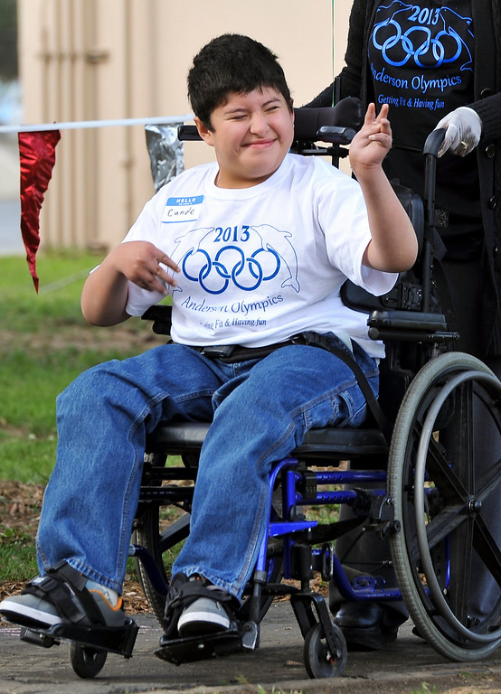 Description of . Special needs students participate in the annual olympic games at Anderson School in San Bernardino on Friday, March 15, 2013. Students were involved in activities including a relay race, long jump, kickball and more. (Rachel Luna / Staff Photographer)