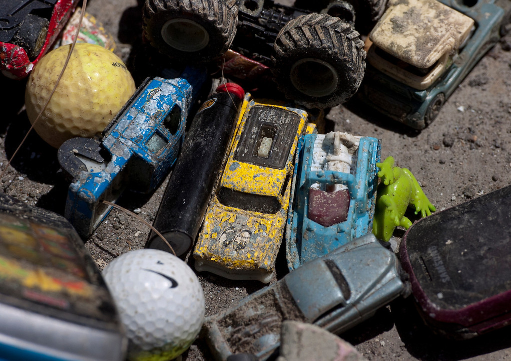 . Toys found in the lake at Red Hill Park in Rancho Cucamonga, CA, Thursday, June 5, 2014. (Photo by Jennifer Cappuccio Maher/Inland Valley Daily Bulletin)