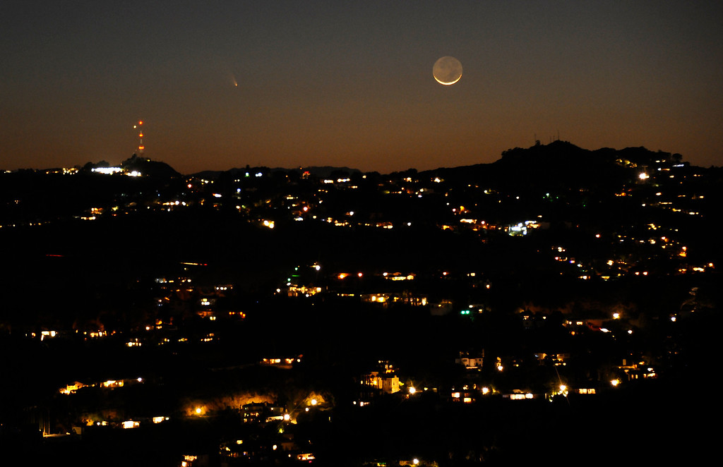 Description of . March 12,2013. Los Angeles CA.  The comet Pan-STARRS as seen on the western coast of Southern California with the waxing crescent  moon Tuesday evening.  The comet will be visible through the end of March.