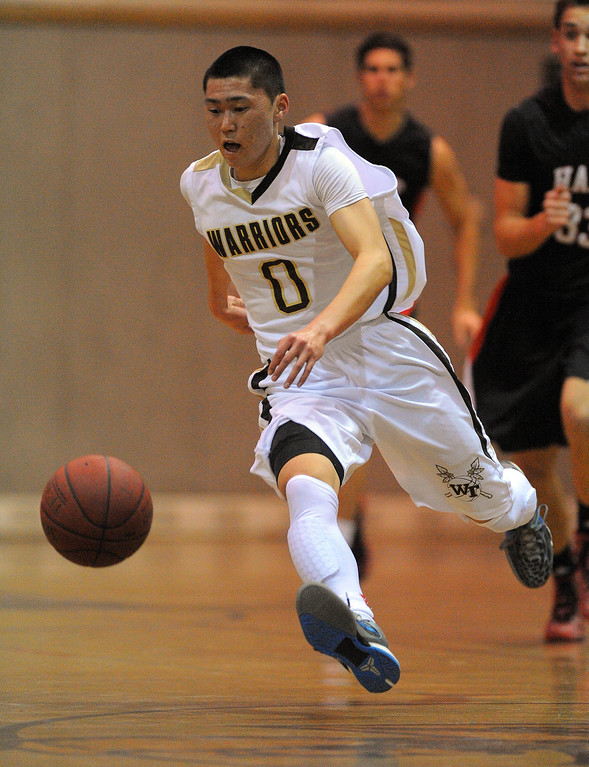 . TORRANCE - 02/15/2013 - (Staff Photo: Scott Varley/LANG) In a CIF Southern Section Division III-AAA second-round boys basketball matchup, West beat Hart 64-55. West\'s Ethan Kishimoto chases down a loose ball.