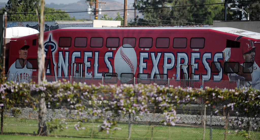 Description of . A metro link train with an Angels advertisement passes by during a prep baseball game between Baldwin Park and Northview at Northview High School on Tuesday, April 23, 2012 in Covina, Calif. Northview won 8-2.    (Keith Birmingham/Pasadena Star-News)