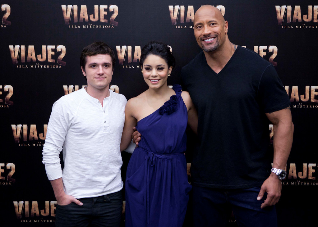". Actors Josh Hutcherson, left, Vanessa Hudgens, center, and Dwayne \'The Rock\' Johnson pose for the press at a press conference promoting their new movie ""Journey 2: The Mysterious Island\"" in Mexico City, Friday Jan. 27, 2012. (AP Photo/Eduardo Verdugo)"