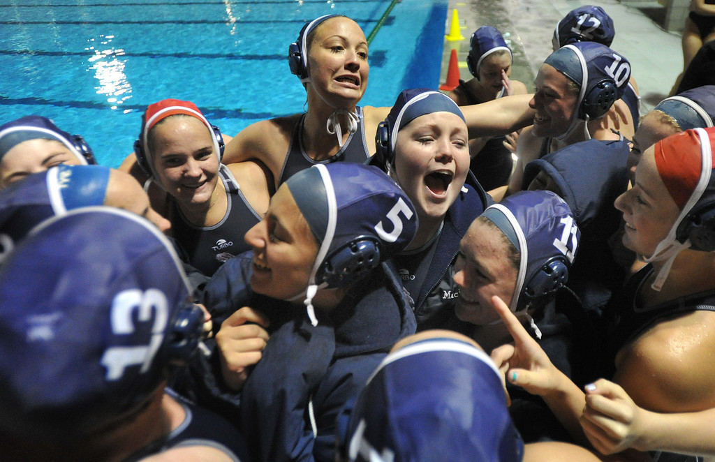 Description of . Crescenta Valley players celebrate their win over Redlands East Valley in the Southern Section Div. V semifinals girls water polo game at Whittier College's Lillian Slade Aquatics Center on Wednesday February 20, 2013. Crescenta Valley beat Redlands East Valley 14-4. (Staff photo by Keith Durflinger)