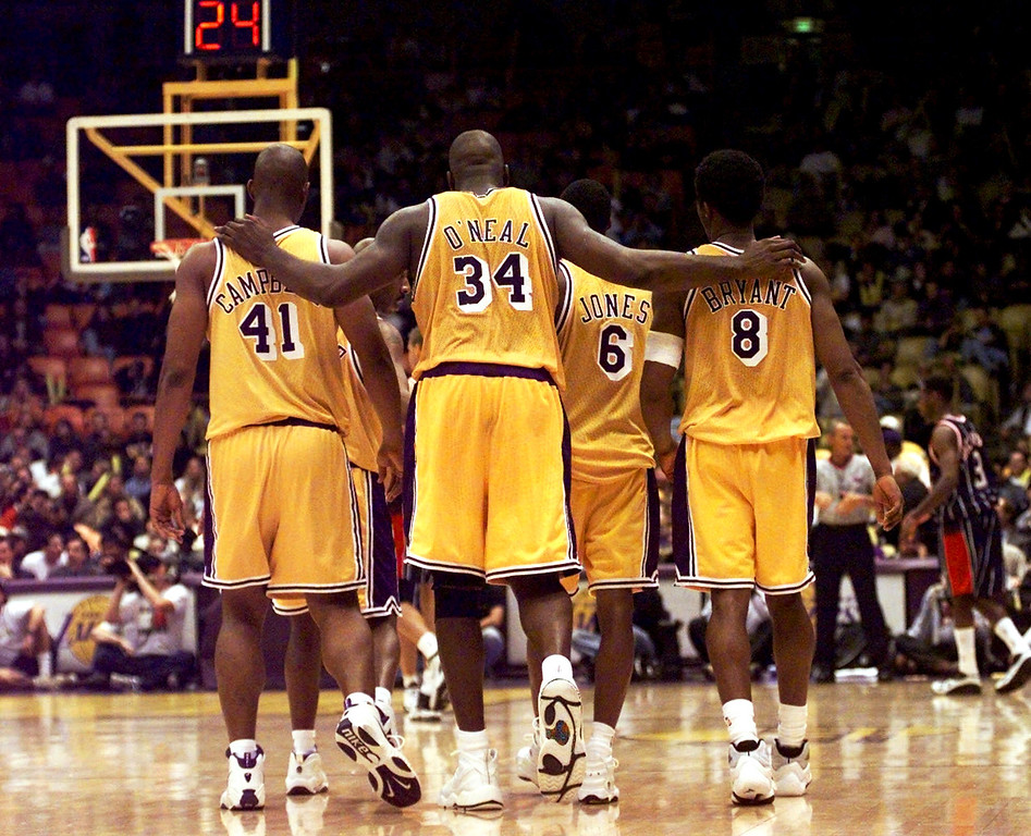 """. FILE- This Feb. 5, 1999 file photo shows Los Angeles Lakers center Shaquille O\'Neal (34) putting his arms around teammates, Elden Campbell (41) and Kobe Bryant (8) as Eddie Jones (6) and Derek Harper walk in front as they return to play the Houston Rockets in the fourth quarter at the Great Western Forum in Inglewood, Calif. O\'Neal says on Twitter that he\'s \""""about to retire.\"""" O\'Neal sent a Tweet shortly before 2:45 p.m. saying, \""""im retiring.\"""" It included a link to a 16-second video in which he says, \""""We did it; 19 years, baby. Thank you very much. That\'s why I\'m telling you first: I\'m about to retire. Love you. Talk to you soon.\"""" (AP Photo/ Victoria Arocho,File)"""