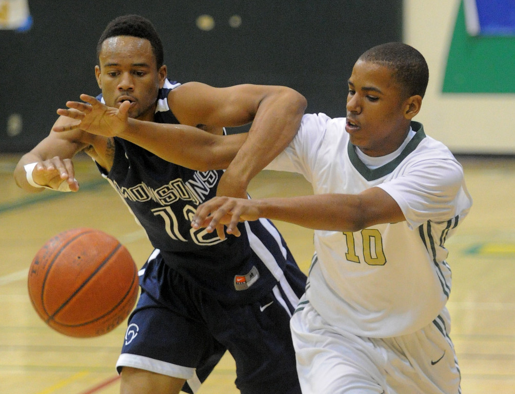 . 02-19-2012--(LANG Staff Photo by Sean Hiller)- Mayfair at Poly in the second round of the Division I-AA boys basketball playoffs Tuesday night. Mayfair\'s Jarrod Sheffield, left, wrestles for the ball with Poly\'s Ke\'jhan Feagin.