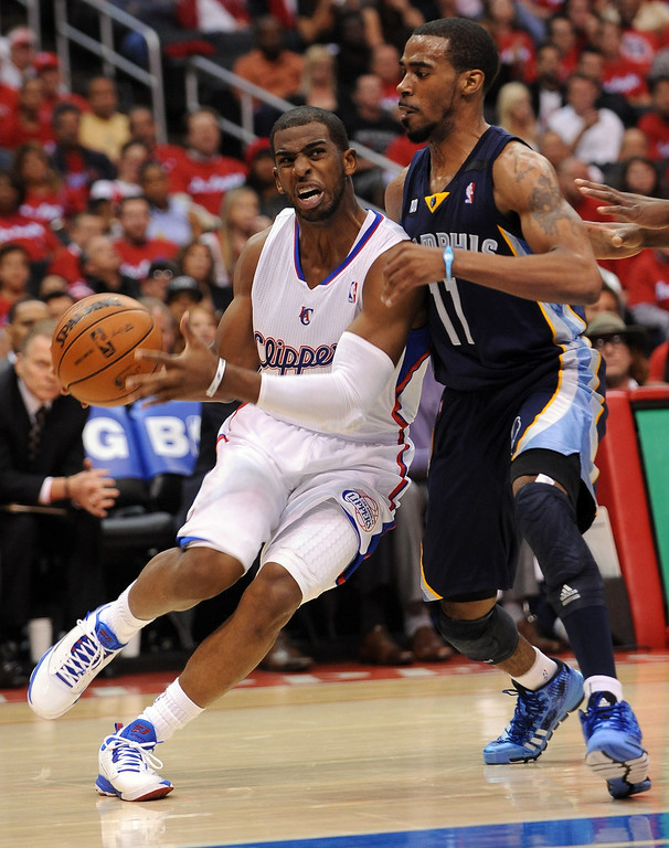 . Clippers guard Chris Paul tries to get around Mike Conley of the Memphis Grizzlies during game 2 of the 2013 NBA Western Conference Playoffs April 22, 2013 in Los Angeles, CA.(Andy Holzman/Staff Photographer)