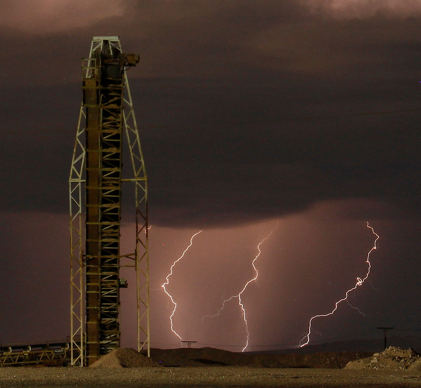 Description of . Lightning strikes and lights up the skies as monsoon storms pass throughout the high deserts area early Monday morning, Aug. 19, 2013 - Newberry Springs CA. Photo by Gene Blevins/LA Daily News
