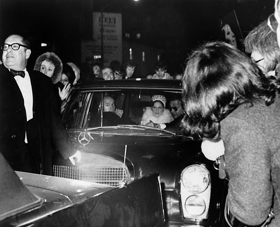 ". Singer-actress Barbra Streisand sits in the rear of a limousine as crowd gathers around the car in front of the Rivoli Theater in New York City December 17, 1969.  The crowd, on hand to see Streisand arrive for the world premiere of film, ""Hello Dolly\"", in which she stars.    Fans trapped Streisand in the car for five minutes, rocking the car and preventing her from leaving.  New York City police shoved the crowd back to allow Streisand to enter the theater.  (AP Photo)"