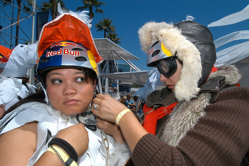 . 08/21/10:  Geese Claudette Baldemor, left, receives help in adjusting her helmet from teammate and pilot Amber Cowan both with the Long Beach Area Convention & Visitors Bureau, prior to the take off of the Flight of the Spruce Goose 2.0 at the Red Bull Flugtag Long Beach at Rainbow Harbor on Saturday, August 21, 2010..Photo by Diandra Jay/Press-Telegram