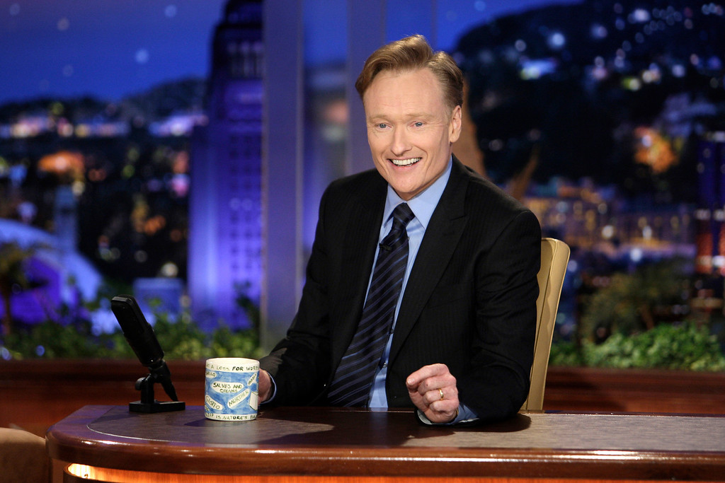 """. FILE - In this June 1, 2009 file photo provided by NBC, Conan O\'Brien  makes his debut as the host of NBC\'s \""""The Tonight Show\""""  in Universal City, Calif. (AP Photo/NBC, Paul Drinkwater)"""