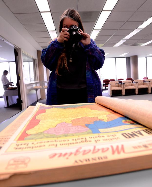 Description of . Special Collections coordinator Jill Vassilakos-Long photographs a 1939 edition of The San Bernardino Daily Sun at California State University San Bernardino April 8, 2013.   GABRIEL LUIS ACOSTA/STAFF PHOTOGRAPHER.